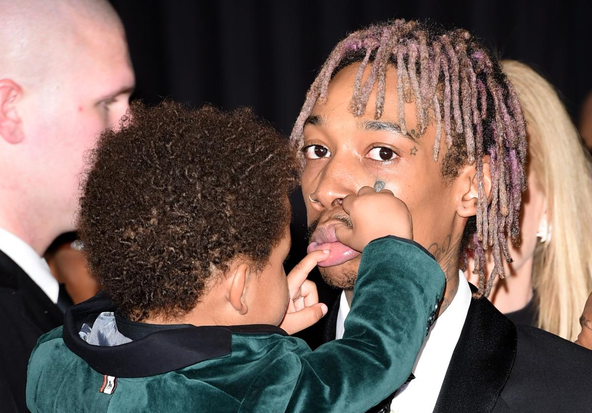 Recording artist Wiz Khalifa (R) and son Sebastian Taylor Thomaz attend The 57th Annual GRAMMY Awards at the STAPLES Center on February 8, 2015