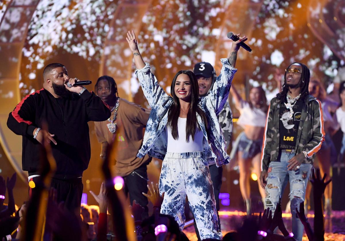 Demi Lovato (C) with DJ Khaled, Travis Scott, Chance the Rapper, and Quavo perform onstage during the 2017 iHeartRadio Music Festival at T-Mobile Arena on September 23, 2017