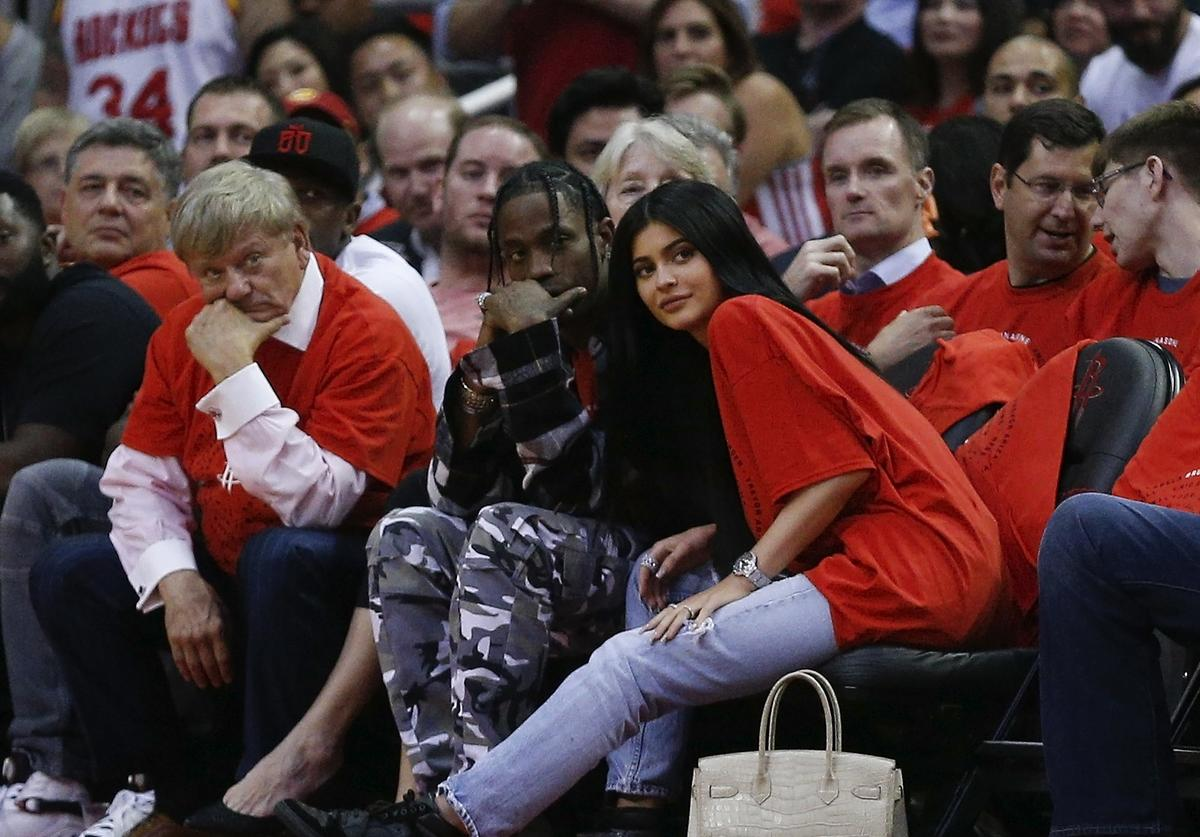 Houston rapper Travis Scott and Kylie Jenner watch courtside during Game Five of the Western Conference Quarterfinals game of the 2017 NBA Playoffs at Toyota Center on April 25, 2017