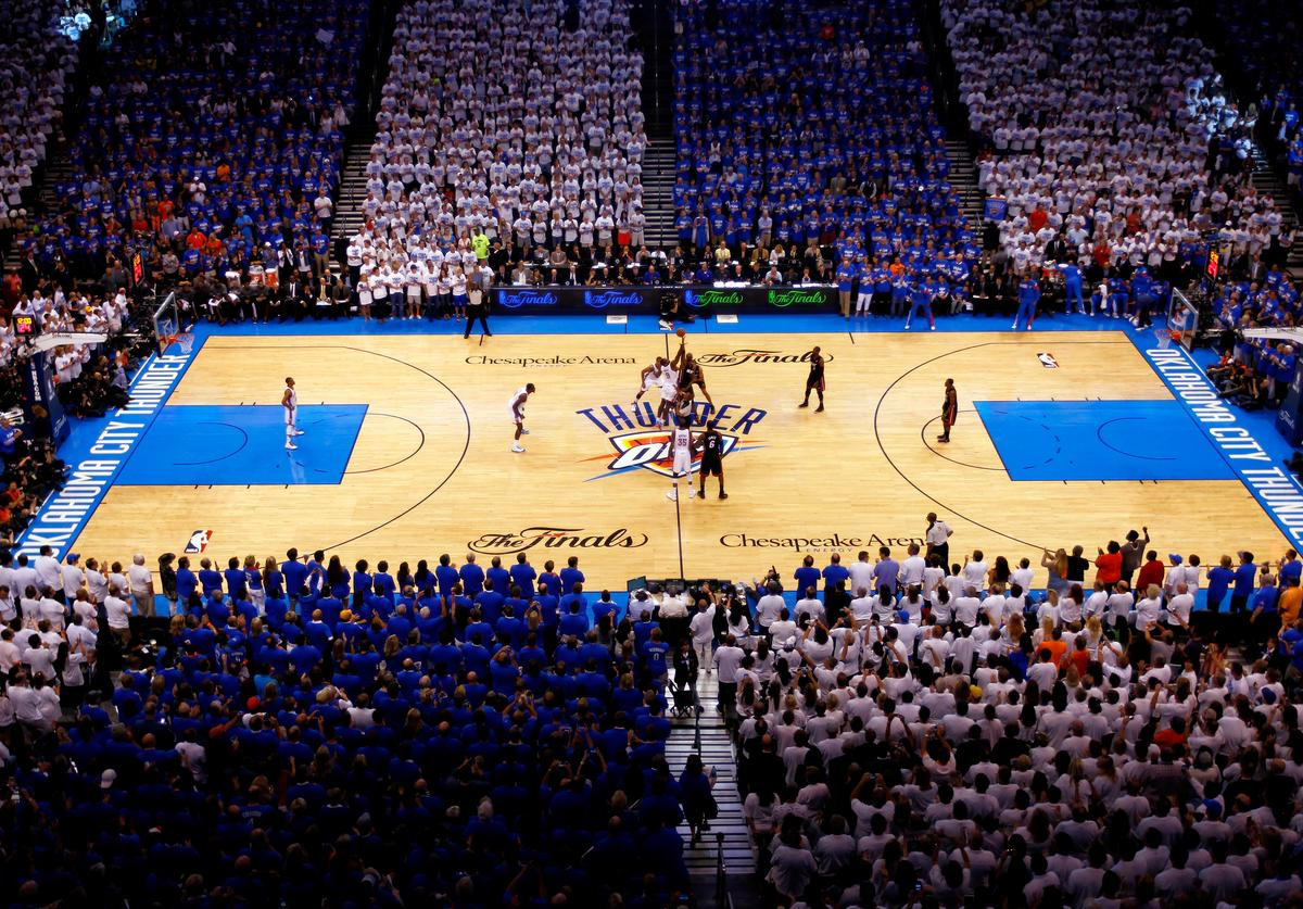 Serge Ibaka #9 of the Oklahoma City Thunder and Chris Bosh #1 of the Miami Heat go after the opening tip to start Game Two of the 2012 NBA Finals at Chesapeake Energy Arena on June 14, 2012 in Oklahoma City, Oklahoma