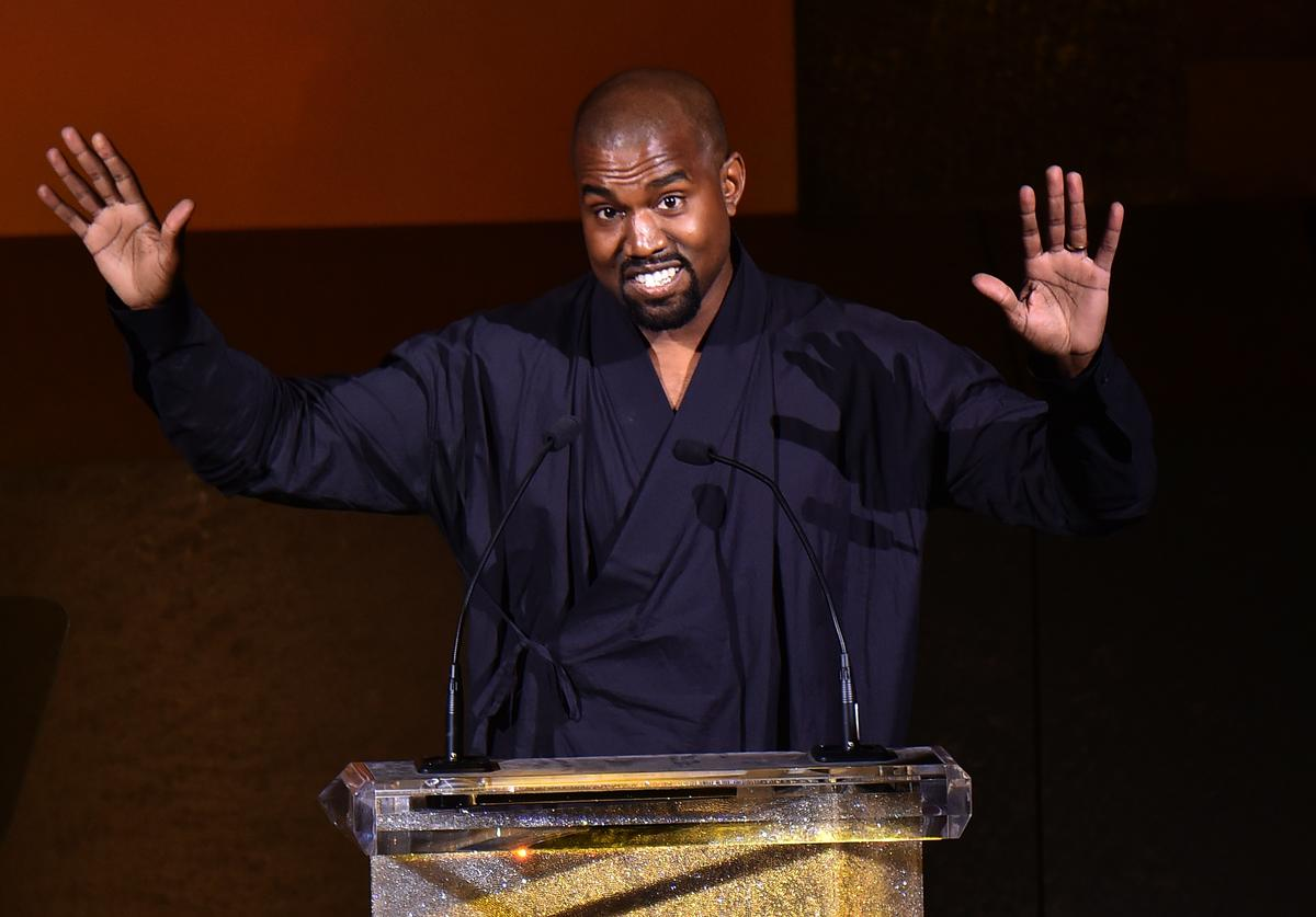 Kanye West presents the Fashion Icon Award to Pharrell Williams onstage at the 2015 CFDA Fashion Awards at Alice Tully Hall at Lincoln Center on June 1, 2015 in New York City