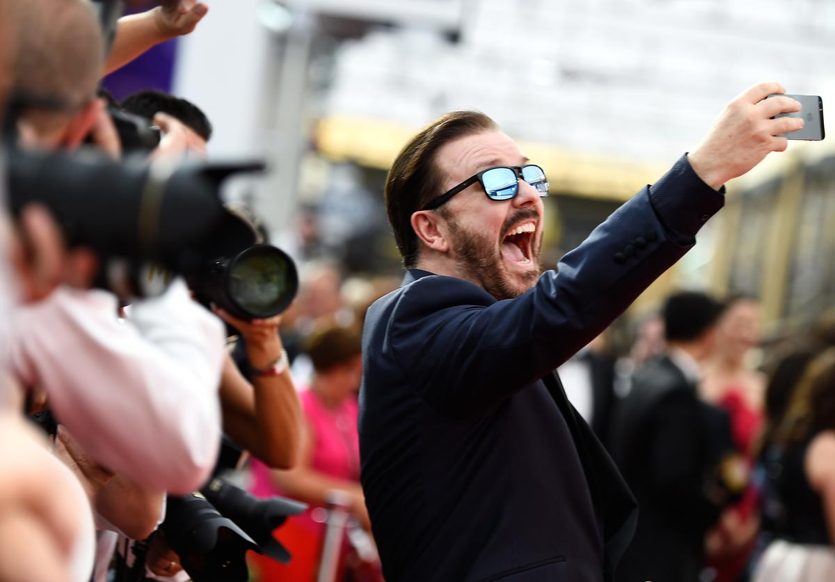 Actor Ricky Gervais takes a selfie at the 67th Annual Primetime Emmy Awards at Microsoft Theater on September 20, 2015 in Los Angeles, California