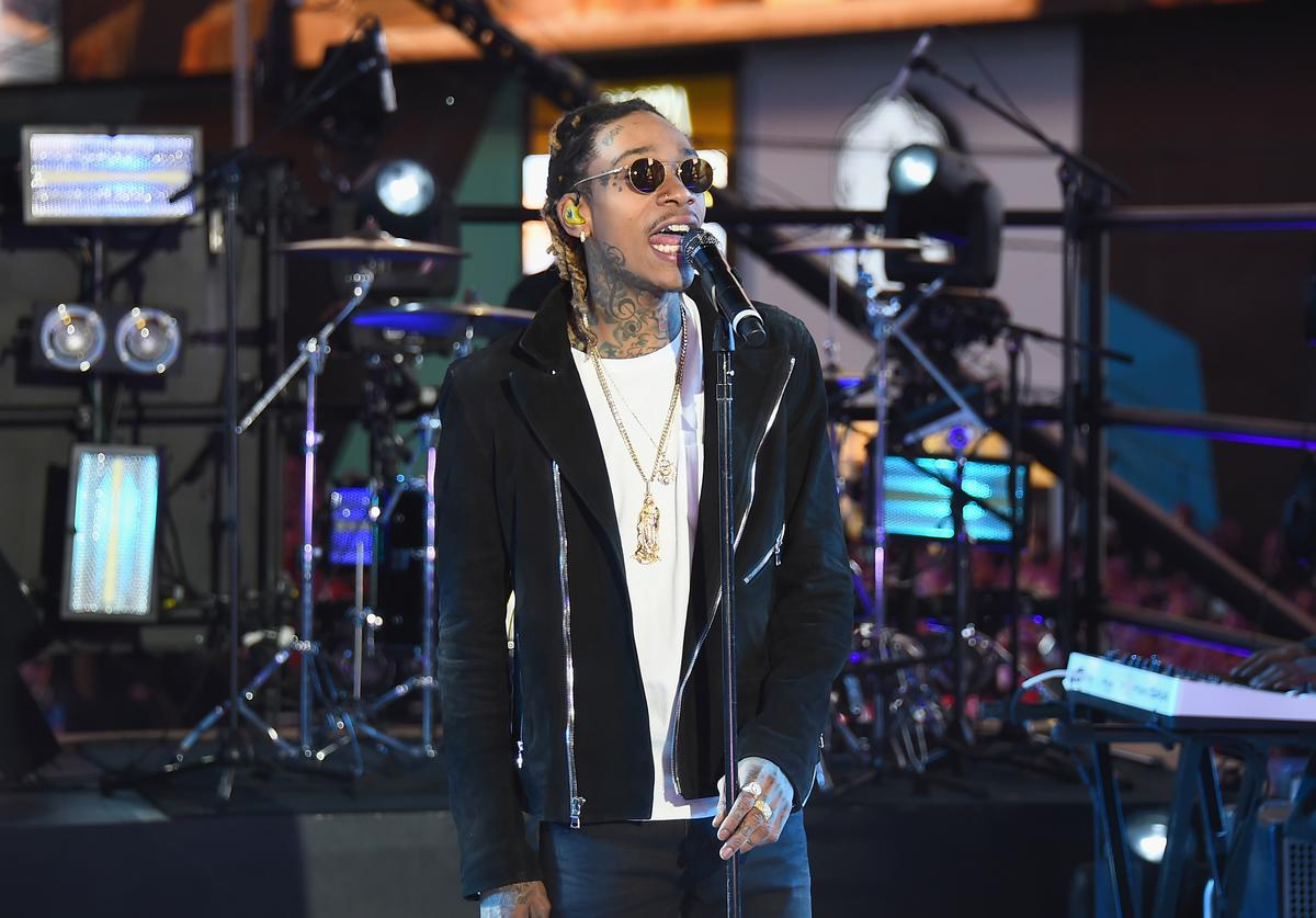 "Recording Artist Wiz Khalifa performs ""See You Again"" on stage with singer Charlie Puth at the Dick Clark's New Year's Rockin' Eve with Ryan Seacrest 2016 on December 31, 2015 in New York City"