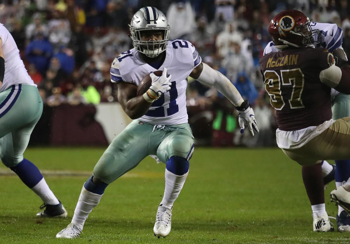 Running back Ezekiel Elliott #21 of the Dallas Cowboys runs upfield against the Washington Redskins during the fourth quarter at FedEx Field on October 29, 2017 in Landover, Maryland