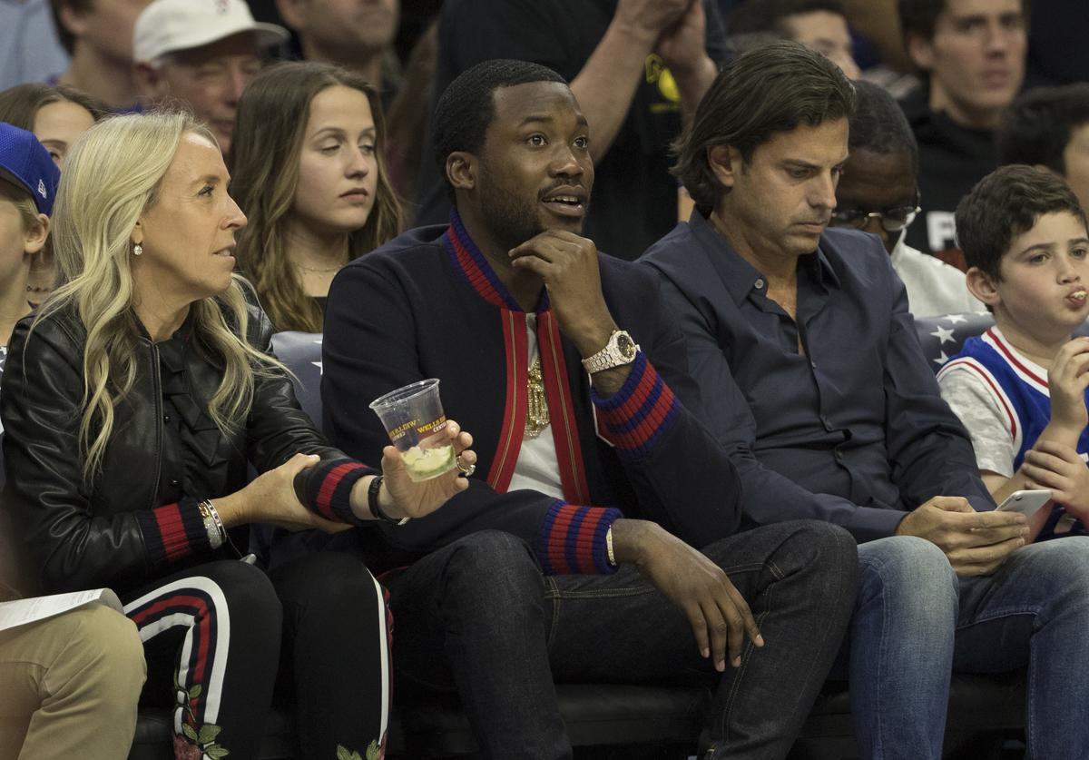 Musical artist Meek Mill watches the game between the Boston Celtics and Philadelphia 76ers at the Wells Fargo Center on October 20, 2017 in Philadelphia, Pennsylvania. The Celtics defeated the 76ers