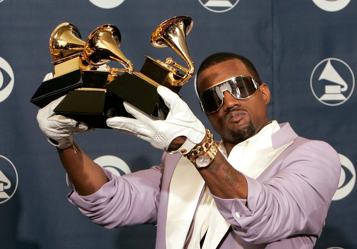Singer Kanye West poses with his Best Rap Song, Best Rap Solo Performance and Best Rap Album awards in the press room at the 48th Annual Grammy Awards at the Staples Center on February 8, 2006 in Los Angeles, California
