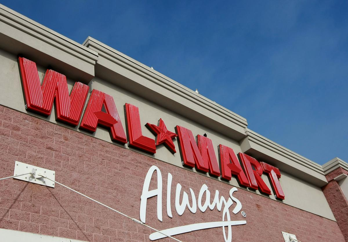 The Wal-Mart logo is displayed on the exterior of a Wal-Mart store January 8, 2009 in Oakland, California. Wal-Mart has posted weaker than expected same store sales for December and has lowered its fourth quarter earnings forecast to 91 cents to 94 cents $1.03 to $1.07 a share