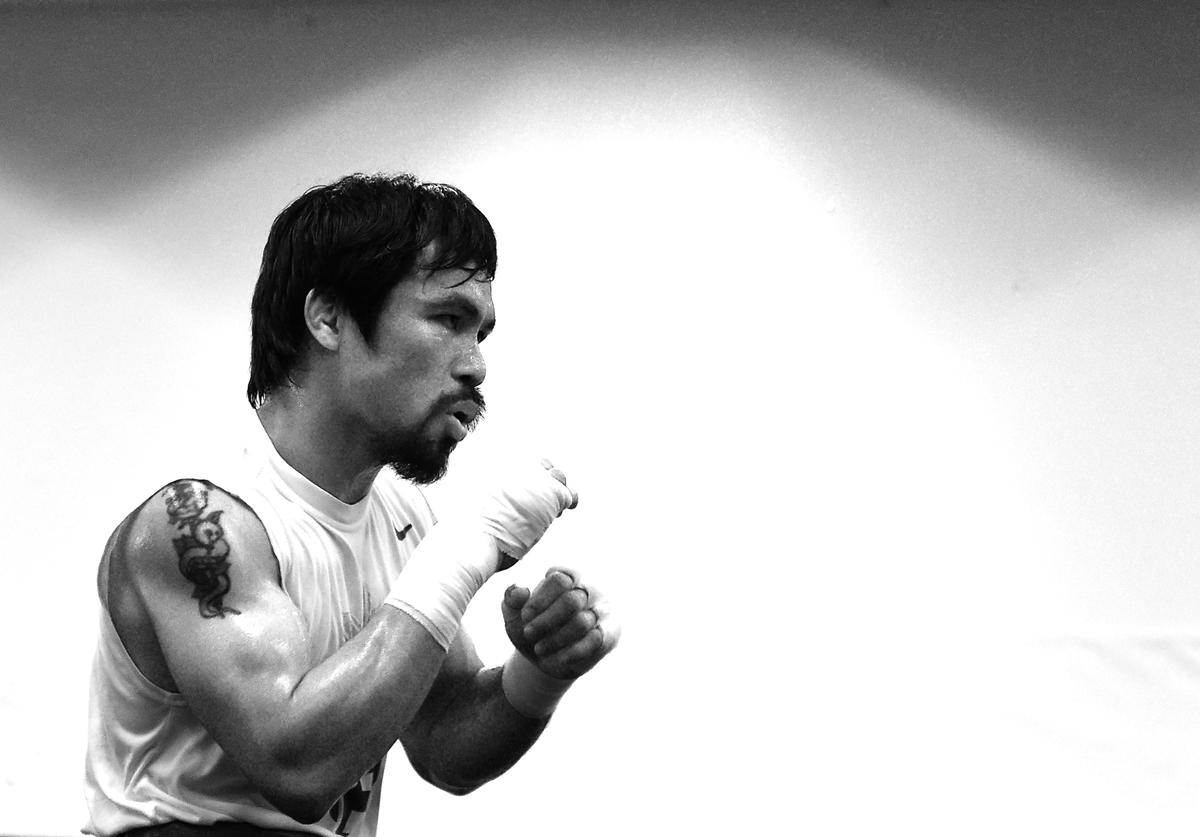 Manny Pacquiao trains in prepation for his fight against Floyd Mayweather Jr. at the Wild Card Boxing Club on April 13, 2015 in Los Angeles, California