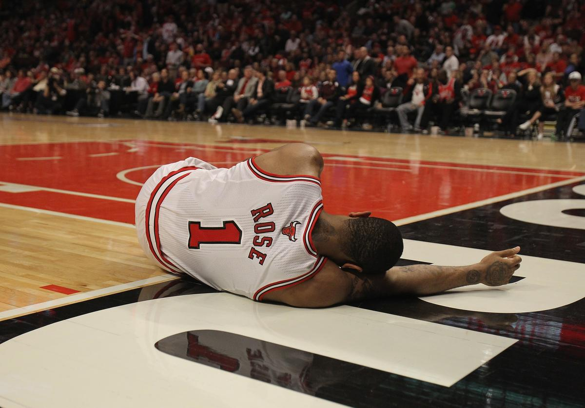 Derrick Rose #1 of the Chicago Bulls lays on the floor aftrer suffering an injury against the Philadelphia 76ers in Game One of the Eastern Conference Quarterfinals during the 2012 NBA Playoffs at the United Center on April 28, 2012 in Chicago, Illinois