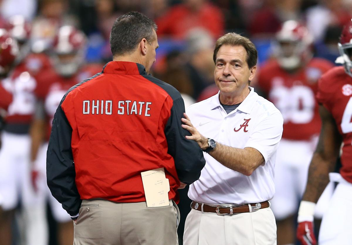 Head coach Urban Meyer of the Ohio State Buckeyes shakes hands with head coach Nick Saban of the Alabama Crimson Tide prior to the All State Sugar Bowl at the Mercedes-Benz Superdome on January 1, 2015 in New Orleans, Louisiana