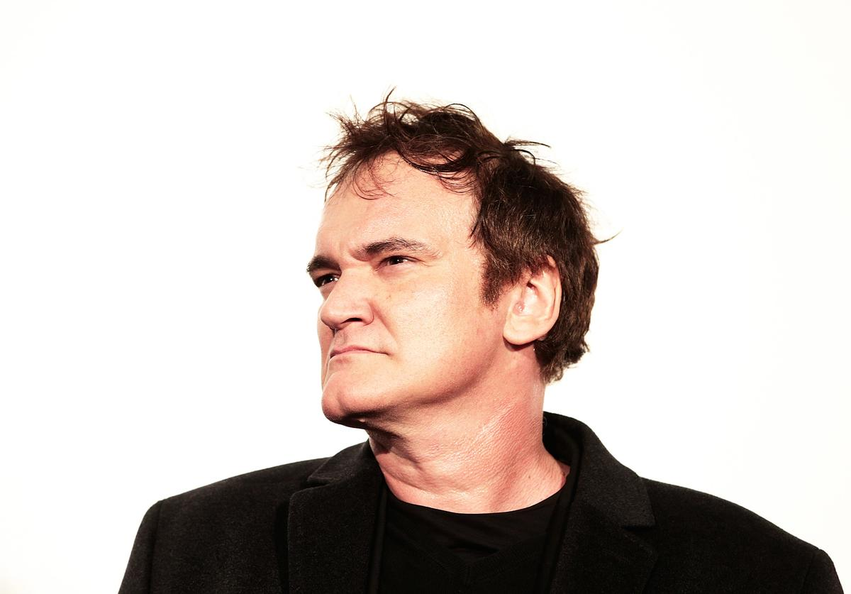 Director Quentin Tarantino poses for photos before the special screening of 'Django Unchained' at Shinjuku Piccadilly on February 13, 2013 in Tokyo, Japan. The film will open on March 1 in Japan.