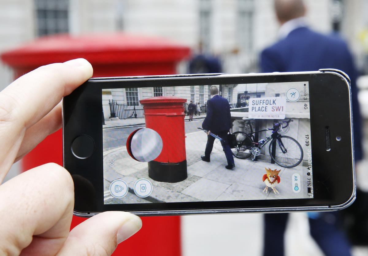 A Spearow, a Pokemon character appears in a London street during a game of Pokemon Go, a mobile game that has become a global phenomenon, on July 15, 2016 in London, England. The app lets players roam using their phone's GPS location data and catch Pokemon to train and battle.The game has added millions to the value of Nintendo, which part-owns the franchise.
