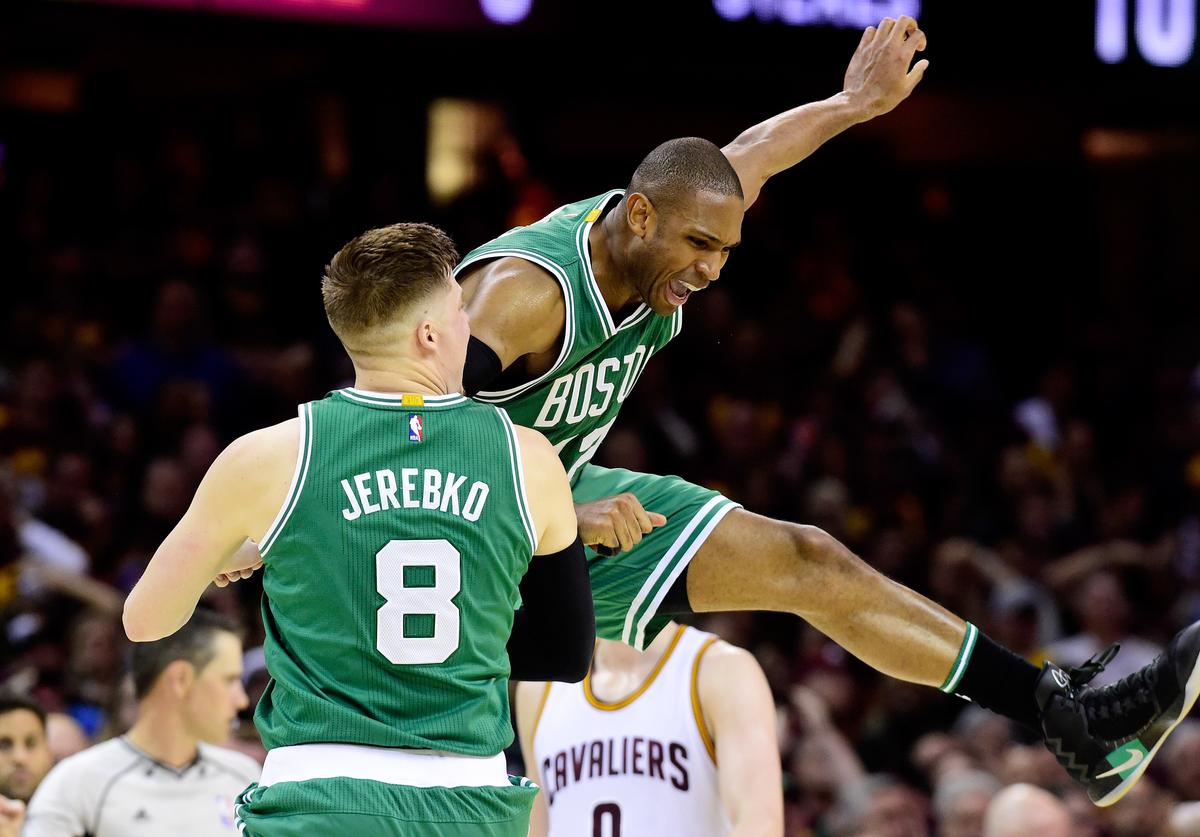 Al Horford #42 celebrates with Jonas Jerebko #8 of the Boston Celtics after their 111 to 108 win over the Cleveland Cavaliers during Game Three of the 2017 NBA Eastern Conference Finals at Quicken Loans Arena on May 21, 2017 in Cleveland, Ohio