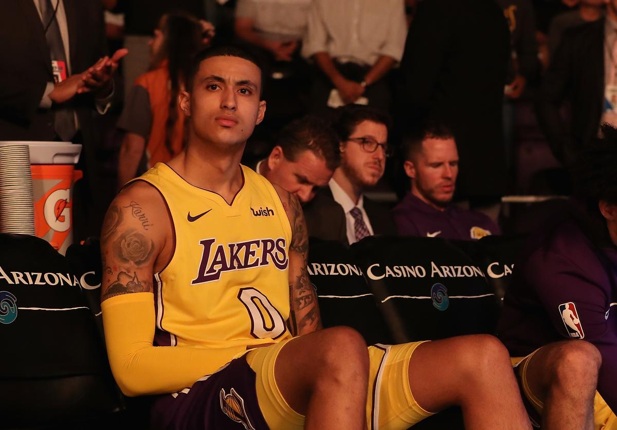 Kyle Kuzma #0 of the Los Angeles Lakers sits on the bench during introductions to the NBA game against the Phoenix Suns at Talking Stick Resort Arena on November 13, 2017 in Phoenix, Arizona