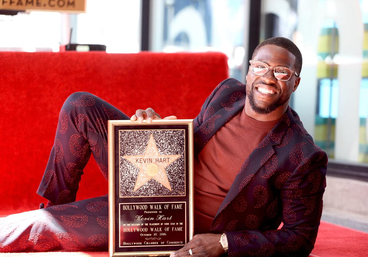 Honoree Kevin Hart poses for a photo as he is honored with a star on the Hollywood Walk of Fame on October 10, 2016 in Hollywood, California