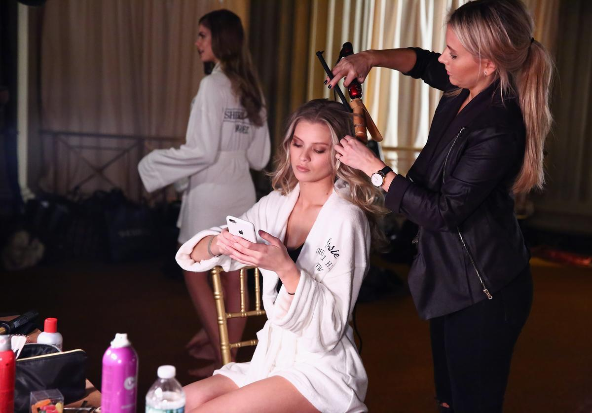 Josie Marie Canseco prepares backstage at the Sherri Hill NYFW Fall 2017 Runway Show during New York Fashion Week at Gotham Hall on February 13, 2017 in New York City