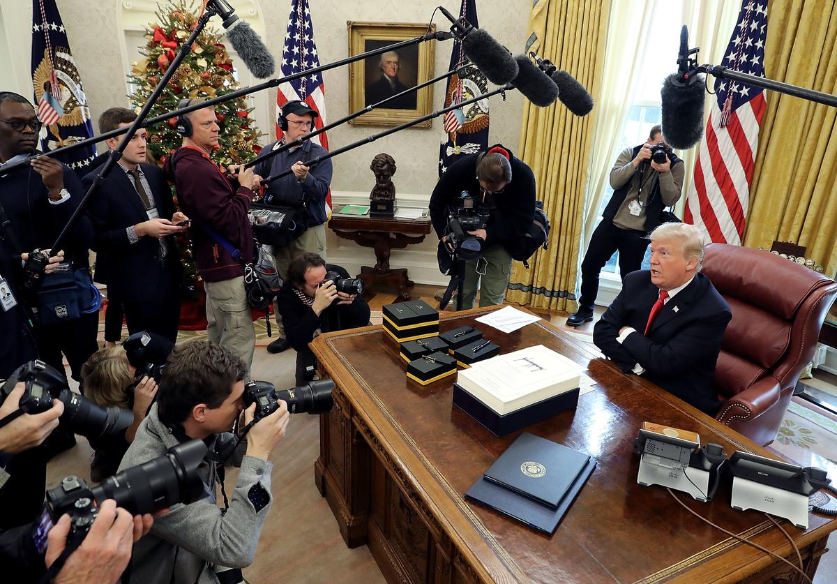 U.S. President Donald Trump talks with journalists after signing tax reform legislation in the Oval Office December 22, 2017 in Washington, DC. Trump praised Republican leaders in Congress for all their work on the biggest tax overhaul in decades