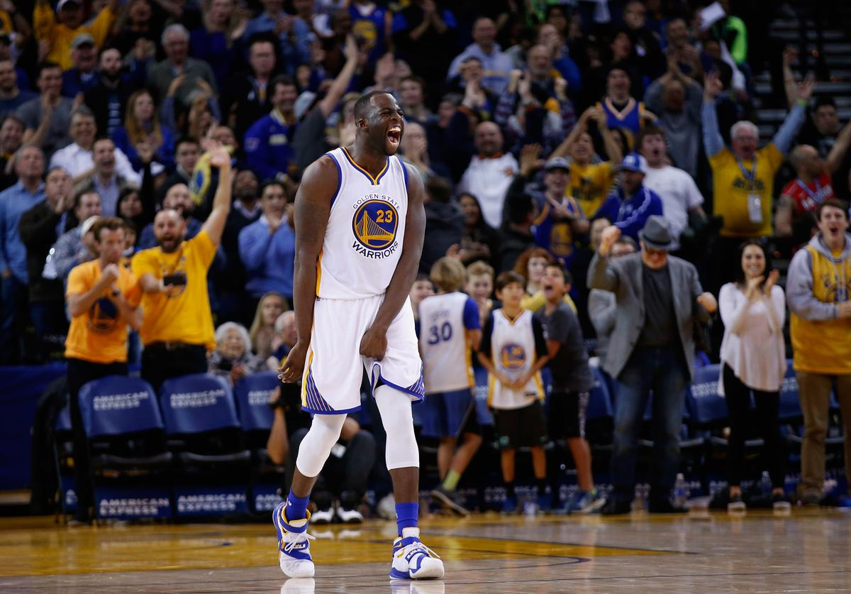 Draymond Green #23 of the Golden State Warriors reacts after he made a three-point basket against the Milwaukee Bucks at ORACLE Arena on December 18, 2015 in Oakland, California.