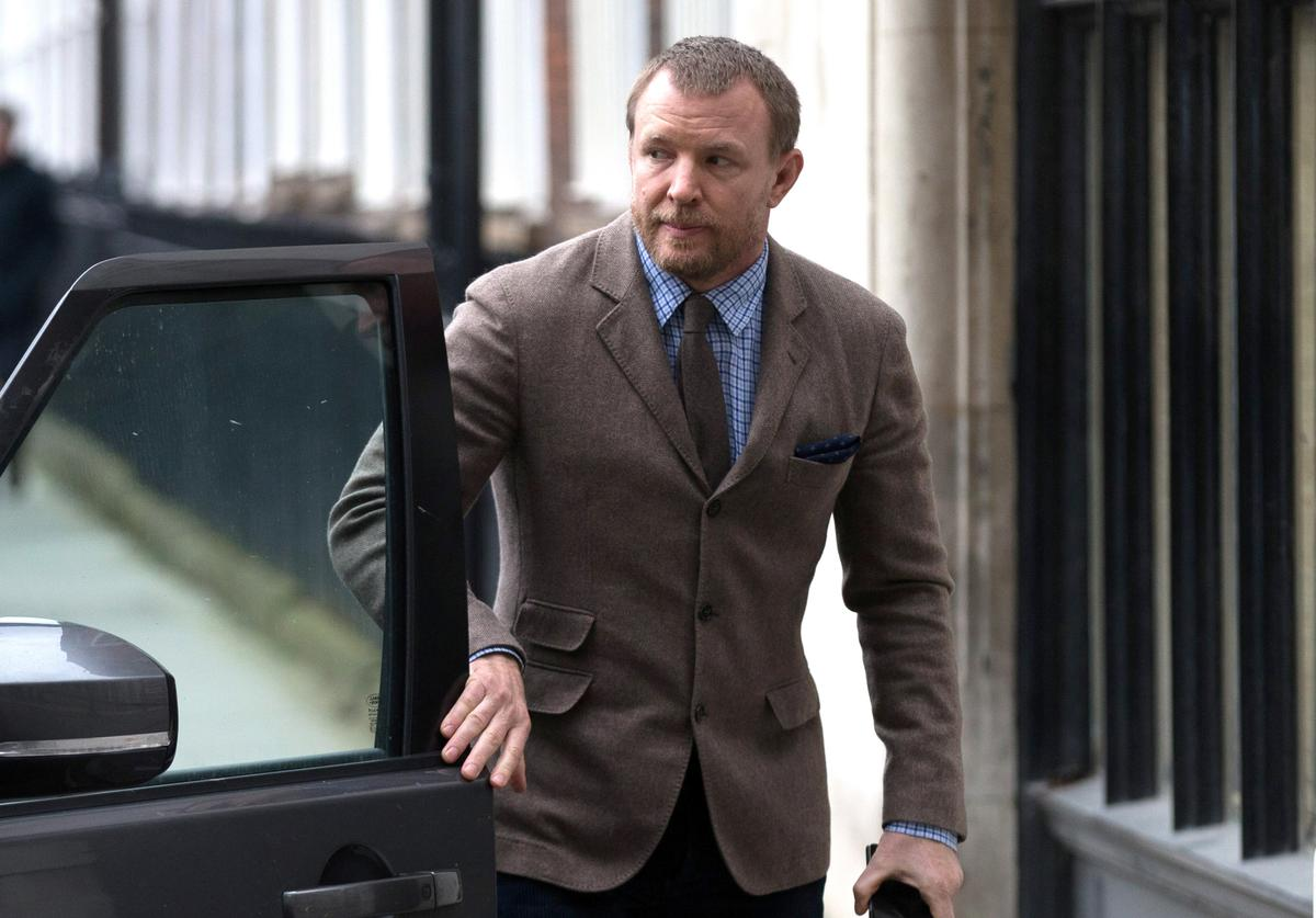 British film director Guy Ritchie arrives at the Royal Courts of Justice, Strand on March 10, 2016 in London, England. Mr Ritchie is currently engaged in a custody battle with his former wife, Madonna, over their son Rocco