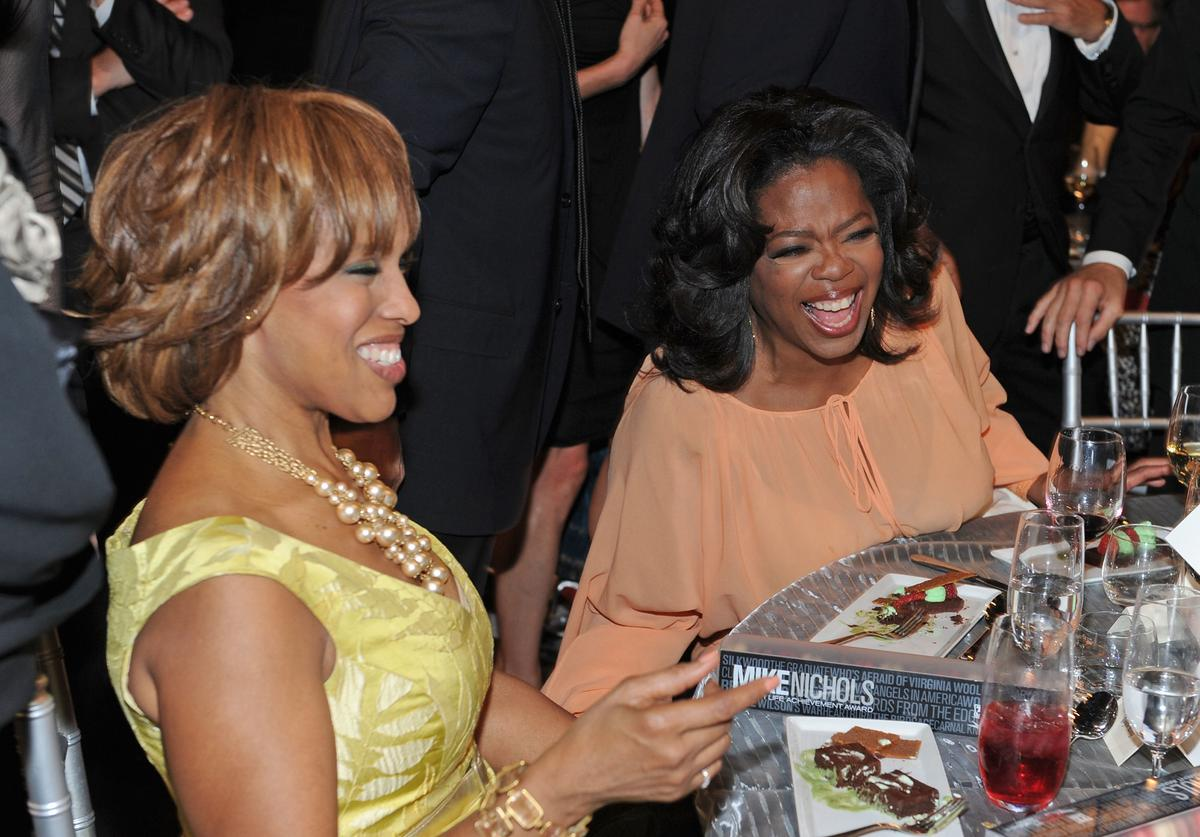 Oprah Winfrey (R) and Gayle King in the audience during the 38th AFI Life Achievement Award honoring Mike Nichols held at Sony Pictures Studios on June 10, 2010 in Culver City, California. The AFI Life Achievement Award tribute to Mike Nichols will premiere on TV Land on Saturday, June 25 at 9PM ET/PST