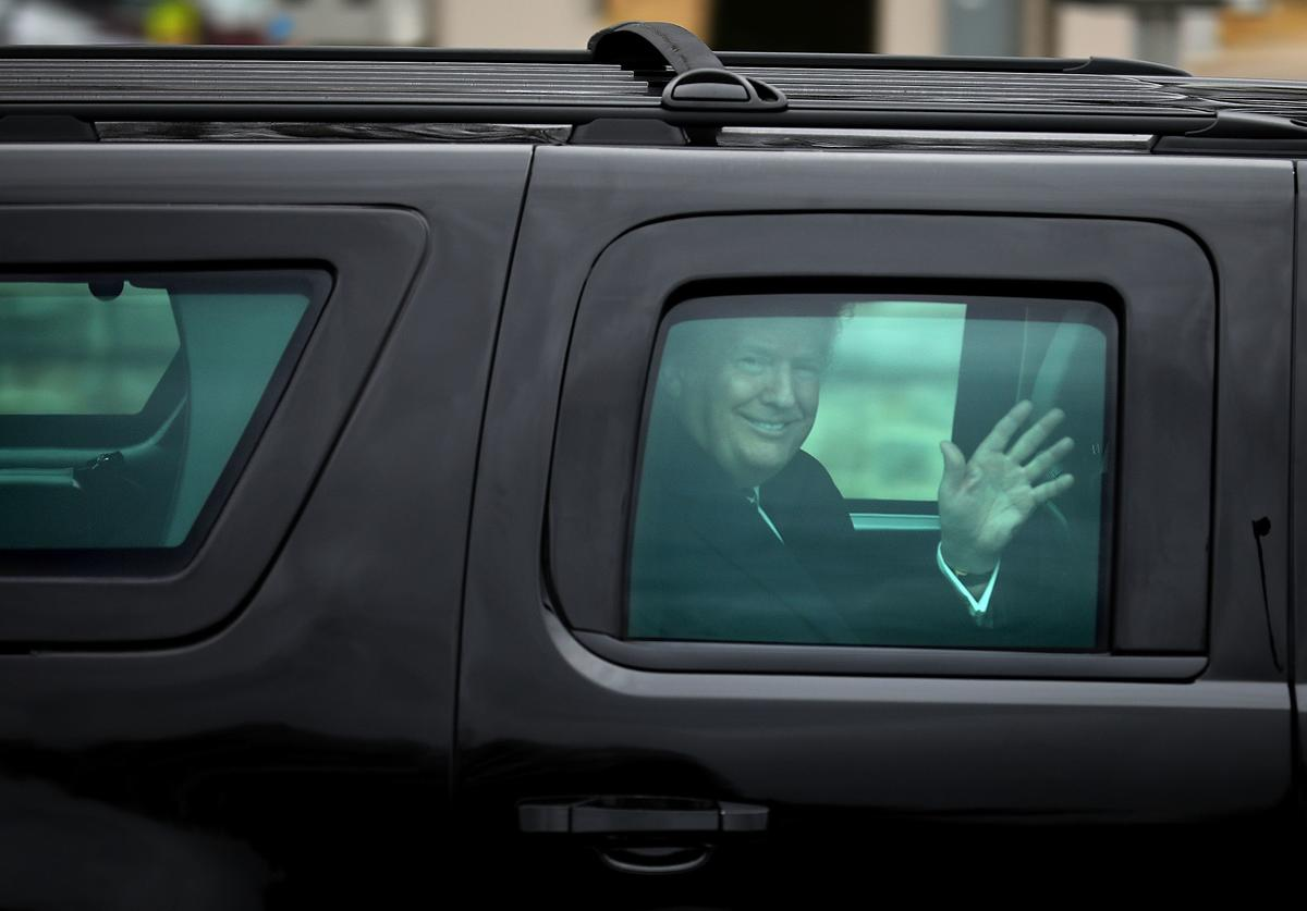 U.S. President Donald Trump waves to journalists as he leaves Walter Reed National Military Medical Center following his annual physical examination January 12, 2018 in Bethesda, Maryland. Trump will next travel to Florida to spend the Dr. Martin Luther King Jr. Day holiday weekend at his Mar-a-Lago resort