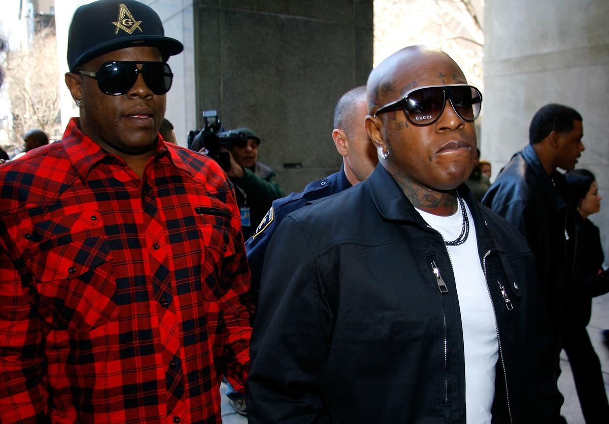 Founders of Cash Money Records Ronald 'Slim' Williams (L) and Bryan 'Birdman' Williams arrive at New York State Supreme Court where Dwayne Carter, known as Lil Wayne, reported to begin serving a one-year prison sentence for possession of an illegal weapon on March 8, 2010 in New York City