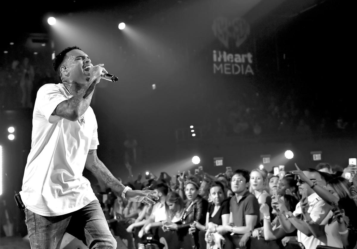 Recording artist Chris Brown performs onstage during iHeartRadio Live with special guest T.I. at the iHeartRadio Theater Los Angeles on June 19, 2015 in Burbank, California.