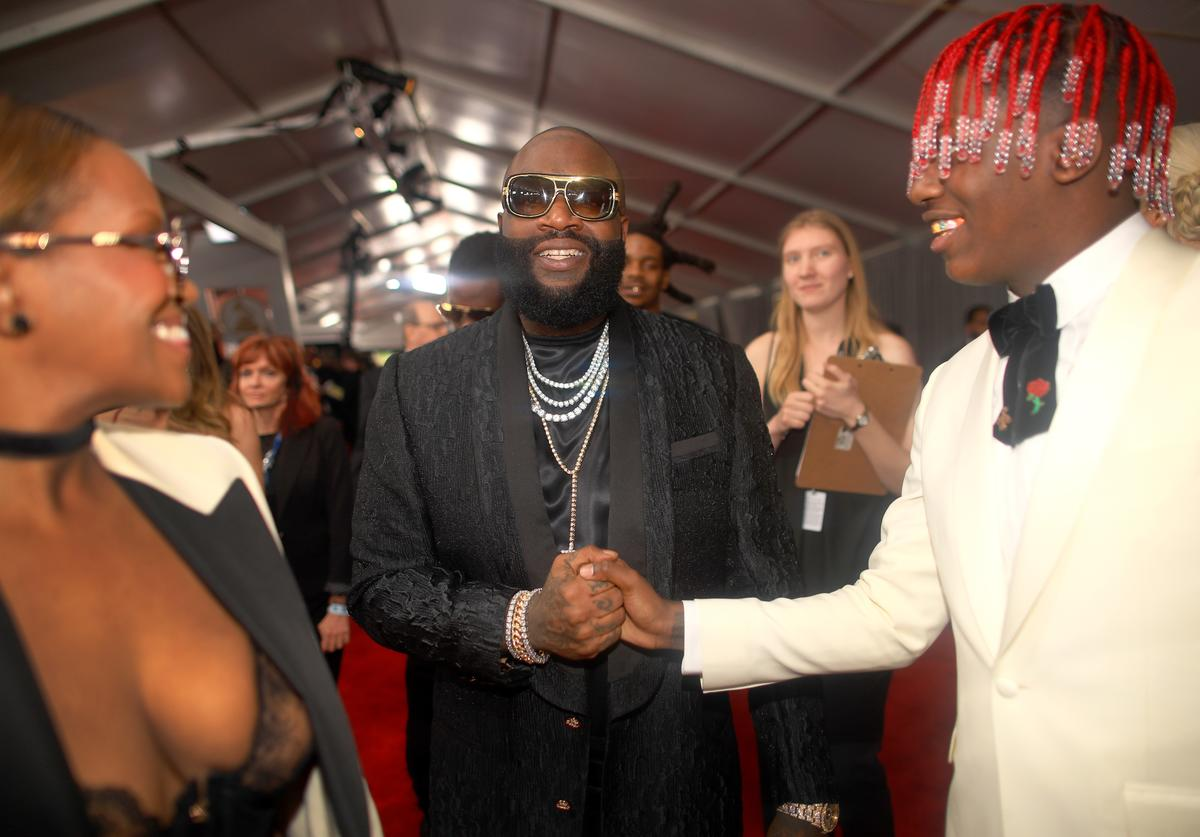 Rapper Rick Ross (C) and Lil Yachty (R) attend The 59th GRAMMY Awards at STAPLES Center on February 12, 2017 in Los Angeles, California