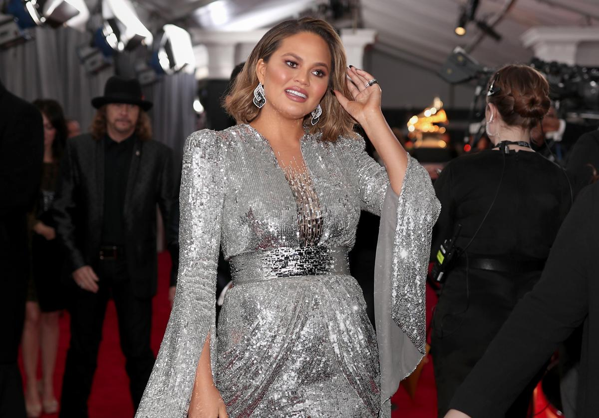 Chrissy Teigen on the red carpet at the 2018 Grammys