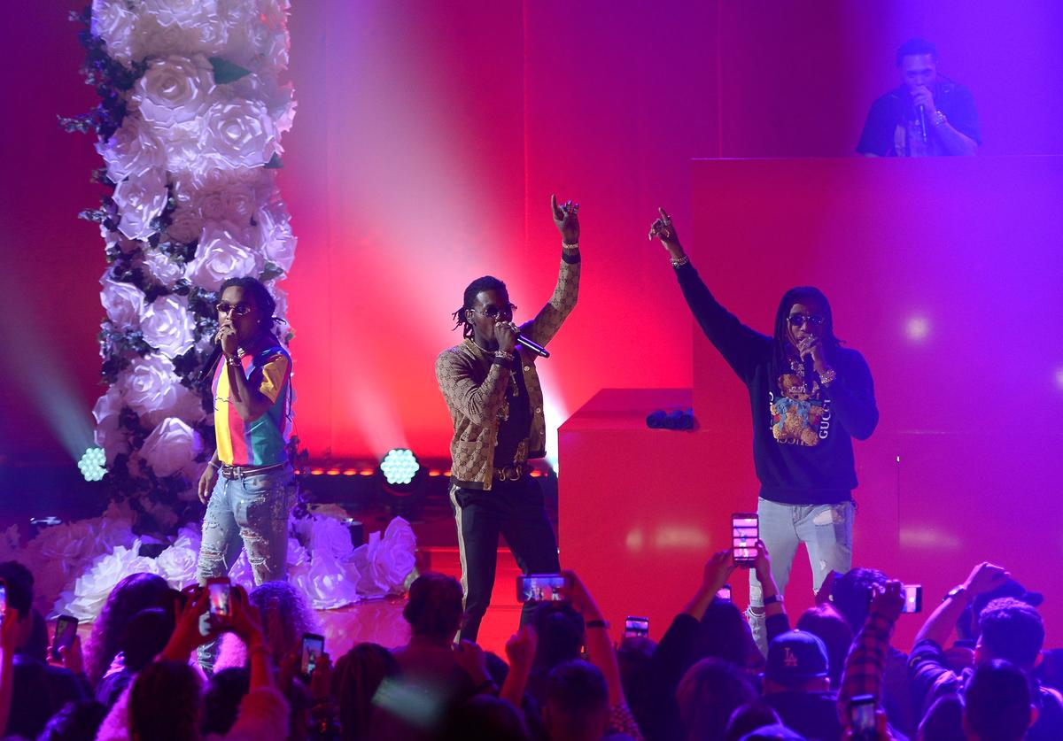 Takeoff, Offset, and Quavo of Migos perform onstage at iHeartRadio album release party with Migos presented by MAGNUM Large Size Condoms at iHeartRadio Theater on January 22, 2018 in Burbank, California.