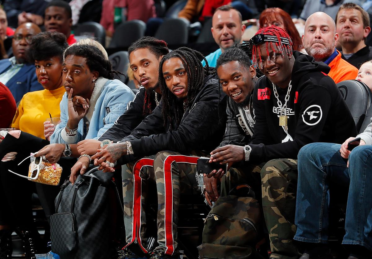 Takeoff, Quavo and Offset of Migos along with Lil Yachty look on during the game between the Atlanta Hawks and Dallas Mavericks at Philips Arena on December 23, 2017 in Atlanta, Georgia