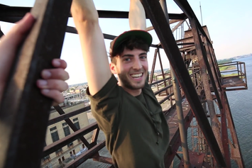 Watch James Lanning Rap While Dangling From Atop A Crane
