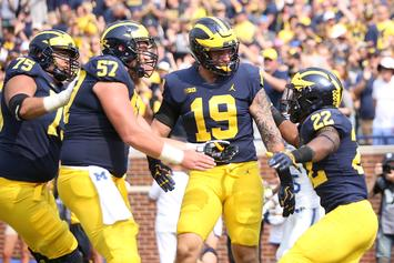 Michigan Football Players Lock Arms in Circle During National Anthem