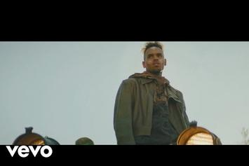 """Chris Brown """"Tempo"""" Video Finds Him Riding a Floating Garbage Truck"""