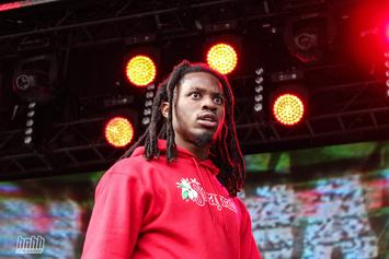 "Denzel Curry Picks Up ""Twisted Ankle"" Jumping Off Stage, Now Confined To Wheelchair"