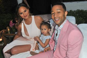 "John Legend & Chrissy Teigen Announce They're Expecting A Baby In ""Wild"" Video"
