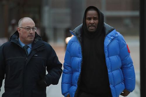 R&B singer R. Kelly (R) and his attorney Steve Greenberg leave Cook County jail after Kelly posted $100 thousand bond on February 25, 2019 in Chicago, Illinois. Kelly was being held after turning himself in to face ten counts of aggravated sexual abuse. (