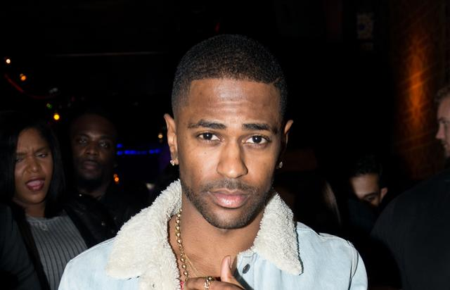 Big Sean showing off his wrist