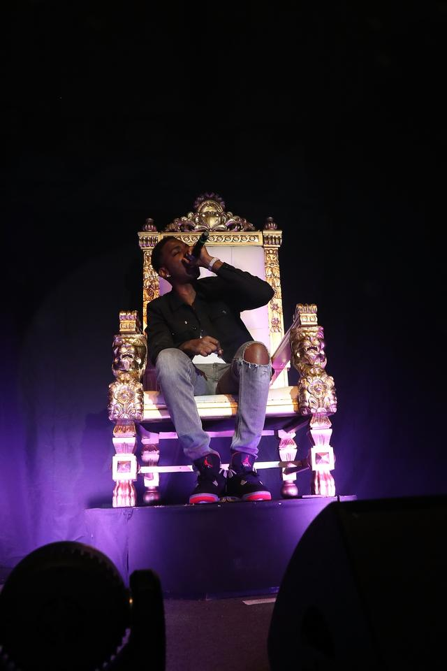 Young Dolph sitting in a throne