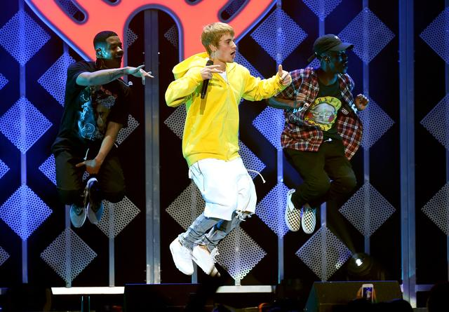 Justin Bieber jumping on stage