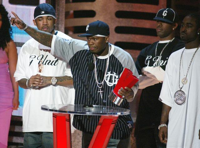 50 Cent, Young Buck Lloyd Banks on stage accepting an award