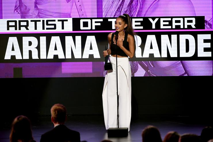 Ariana Grande accepting award at American Music Awards.