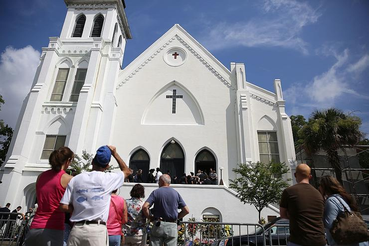 People look on as mourners file into the funeral of Cynthia Hurd, 54, at the Emanuel African Methodist Episcopal Church where she was killed along with eight others in a mass shooting at the church on June 27, 2015 in Charleston, South Carolina