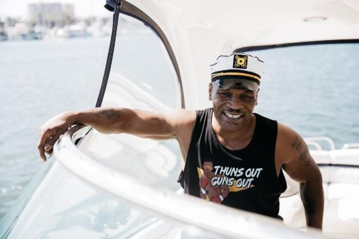 Mike Tyson sails on a boat.