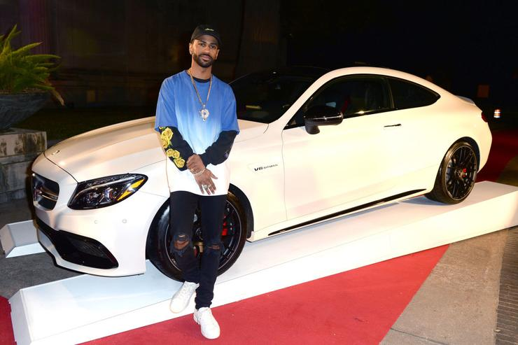 Big Sean leaning on a car at the Rolling Stone Live: Houston presented by Budweiser and Mercedes-Benz on February 4, 2017 in Houston, Texas. Produced in partnership with Talent Resources Sports.