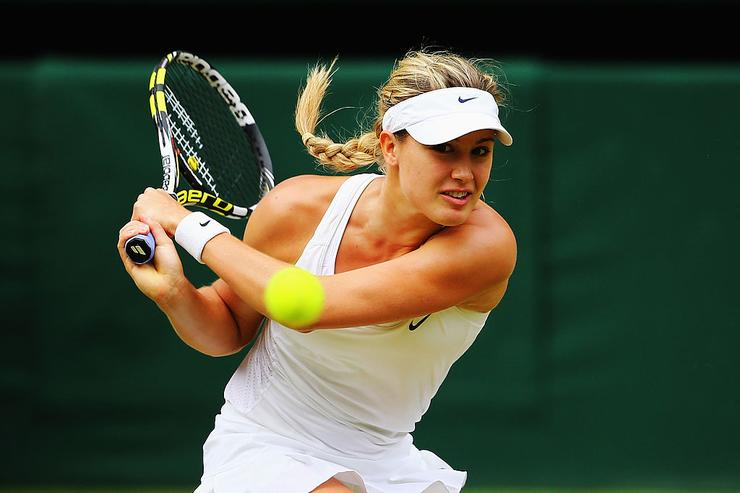 Eugenie Bouchard of Canada plays a backhand return during the Ladies' Singles final match against Petra Kvitova of Czech Republic on day twelve of the Wimbledon Lawn Tennis Championships at the All England Lawn Tennis and Croquet Club on July 5, 2014 in London, England.