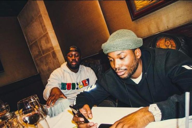 Meek Mill checks his cellphone.