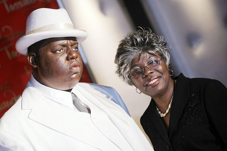 Voletta Wallace poses for a photo with a wax figure of her son Christopher 'Biggie Smalls' Wallace on display at its debut at Madame Tussauds in Times Square on October 25, 2007 in New York City.