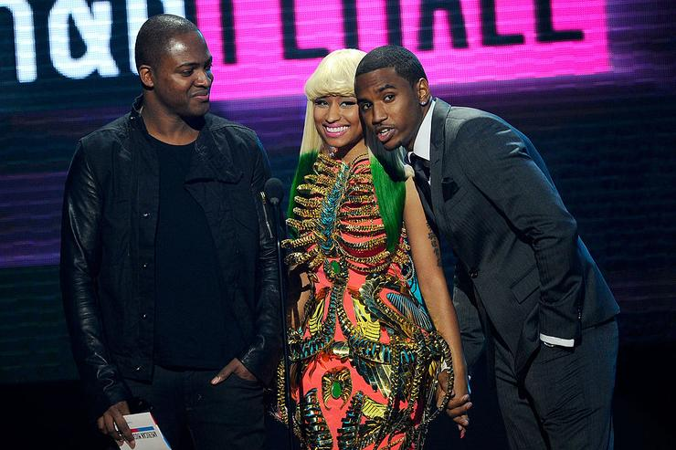 (L-R) Singer Taio Cruz, rapper Nicki Minaj and singer Trey Songz present the Soul/Rhythm & Blues Music - Favorite Female Artist award onstage during the 2010 American Music Awards held at Nokia Theatre L.A. Live on November 21, 2010 in Los Angeles, California.