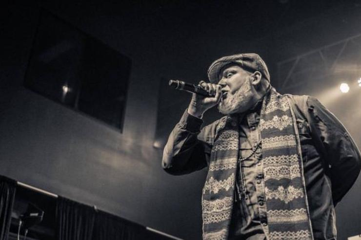 Brother Ali performs at a show.